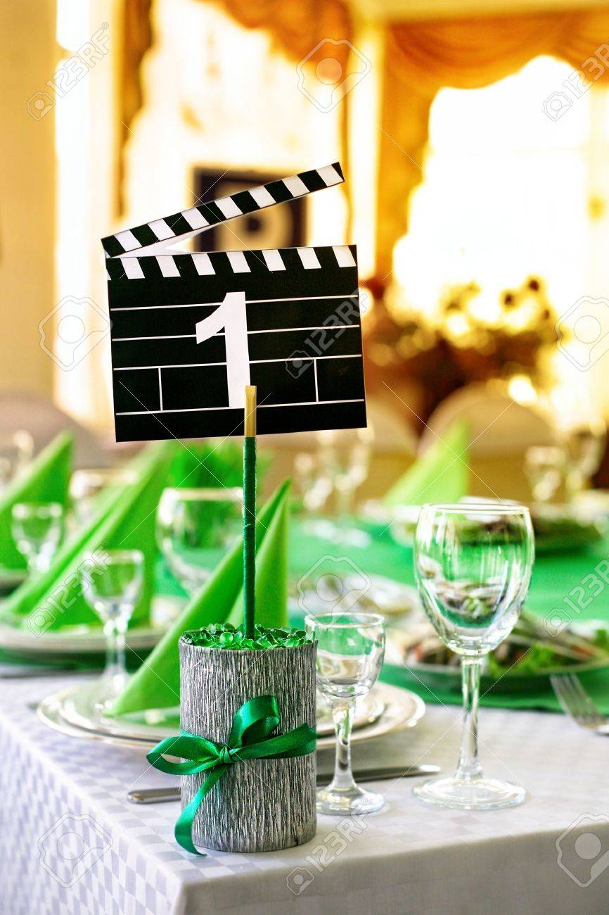 Wedding Table Served In Green Colors In Movie Style With Clapboard ...