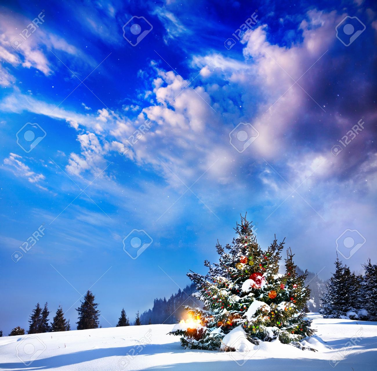 Mountain Christmas Tree.Christmas Tree With Lights In Mountain Snow Forest At Dramatic