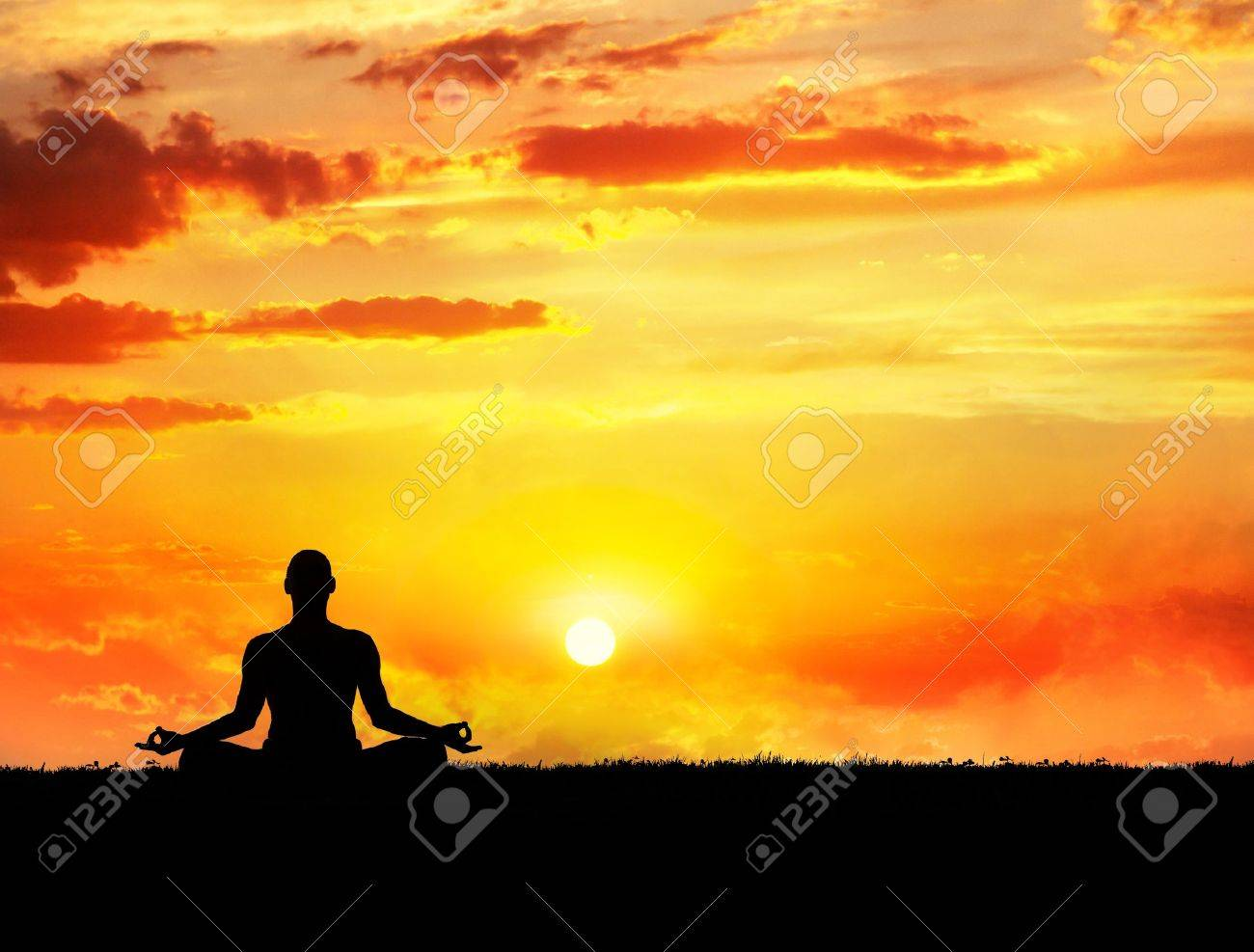 Yoga meditation in lotus pose by man silhouette at sunset sky background. Free space for text and can be used as template for web-site Stock Photo - 11858851