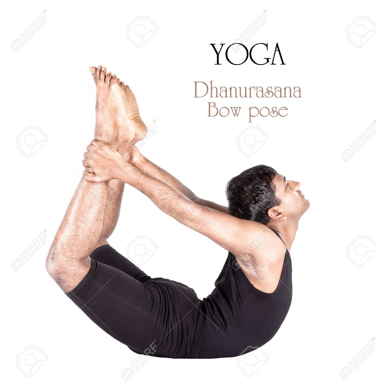 Yoga dhanurasana bow pose by Indian man in black cloth isolated..