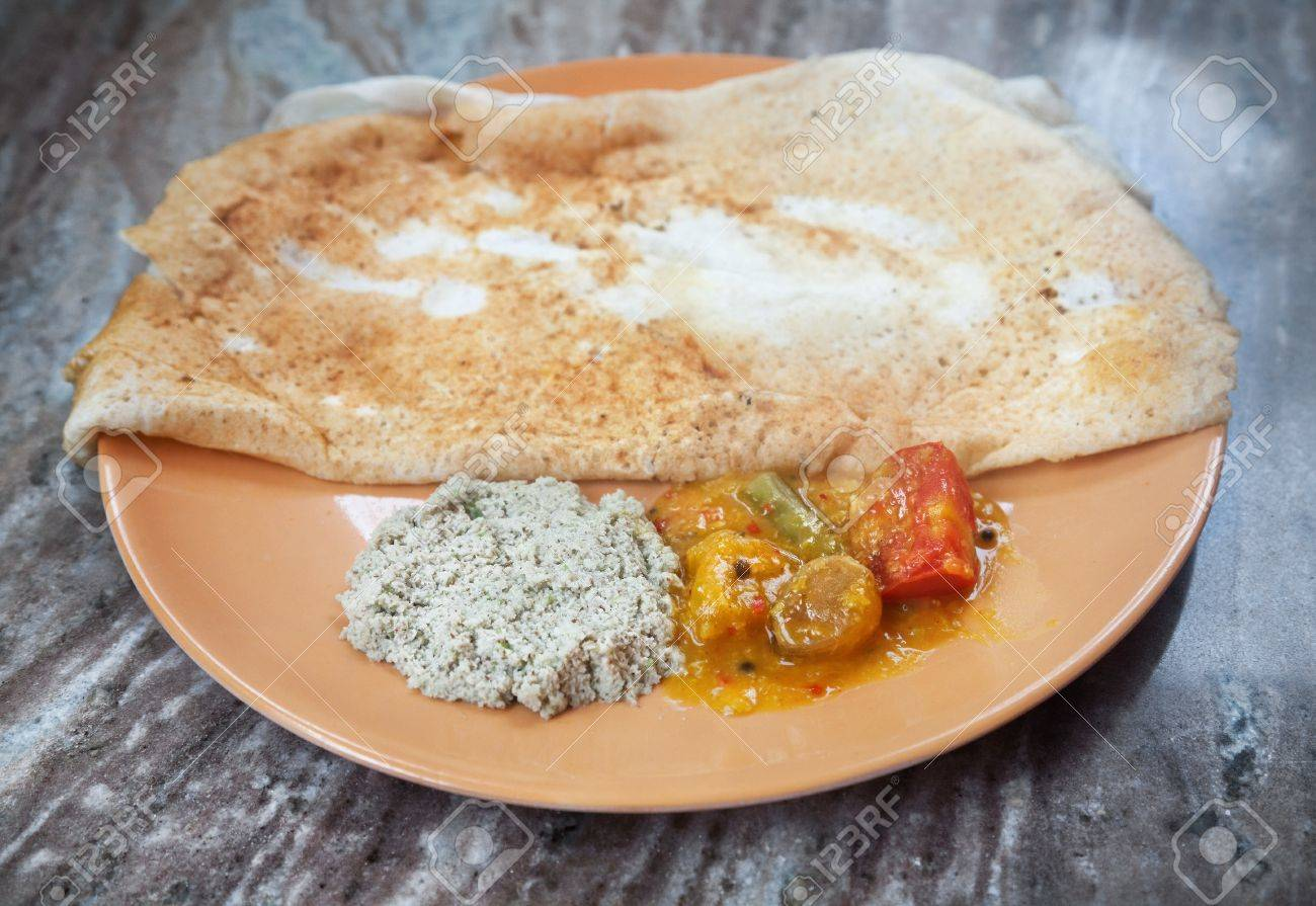 Indian traditional vegetarian masala dosa with potato inside, sambar and coconut chutney nearby at Indian restaurant Stock Photo - 13291250