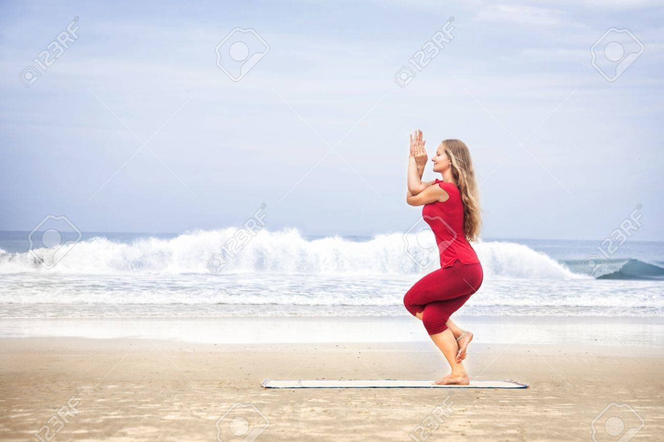 Pleasant Yoga Garudasana Eagle Pose By Young Woman With Long Hair In Red Short Hairstyles For Black Women Fulllsitofus