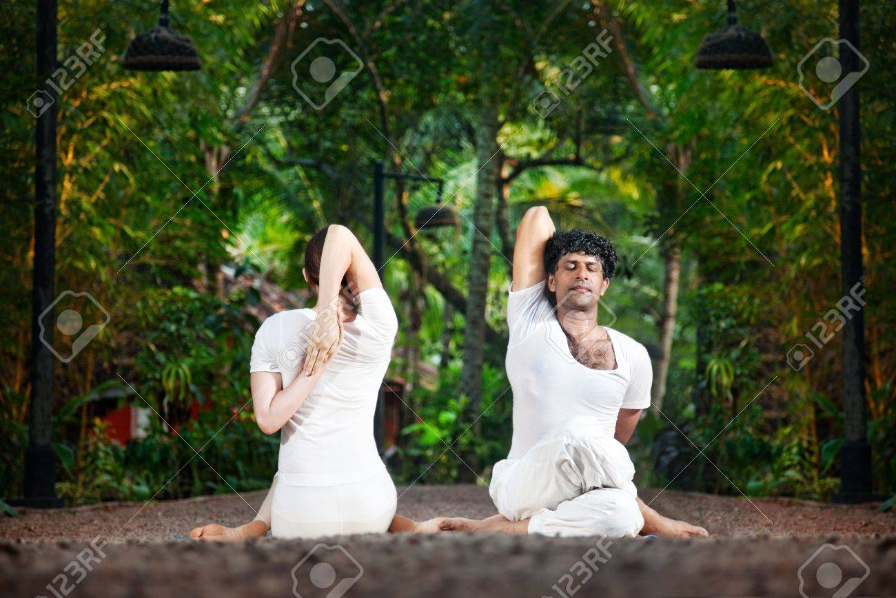 Couple Yoga of man and woman doing gomukhasana cow face pose front and back sides in white cloth in the garden Stock Photo - 13611981