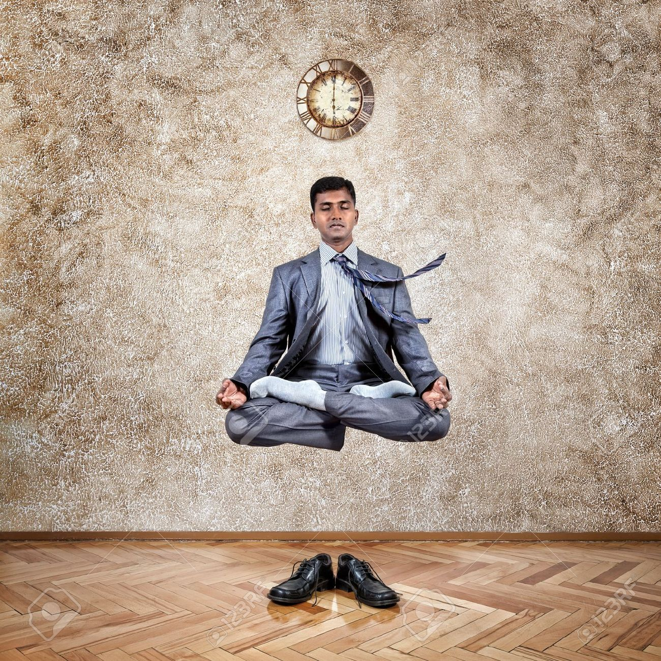 Meditation Businessman Office. Levitation Indian Businessman Lotus Pose The  Office Near Wall With Clock And