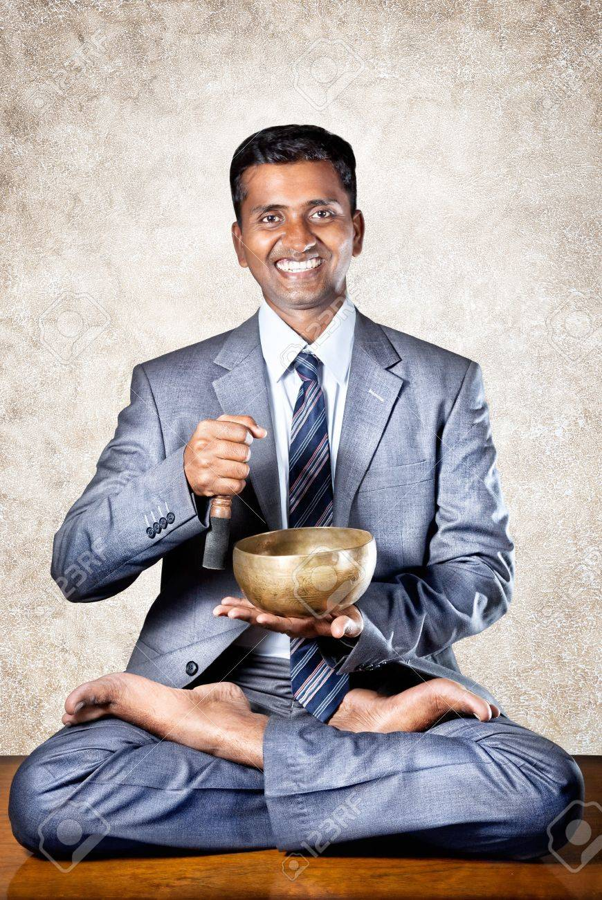meditation businessman office. Indian Businessman Doing Yoga Meditation With Tibetan Singing Bowl On The Table In Office At B