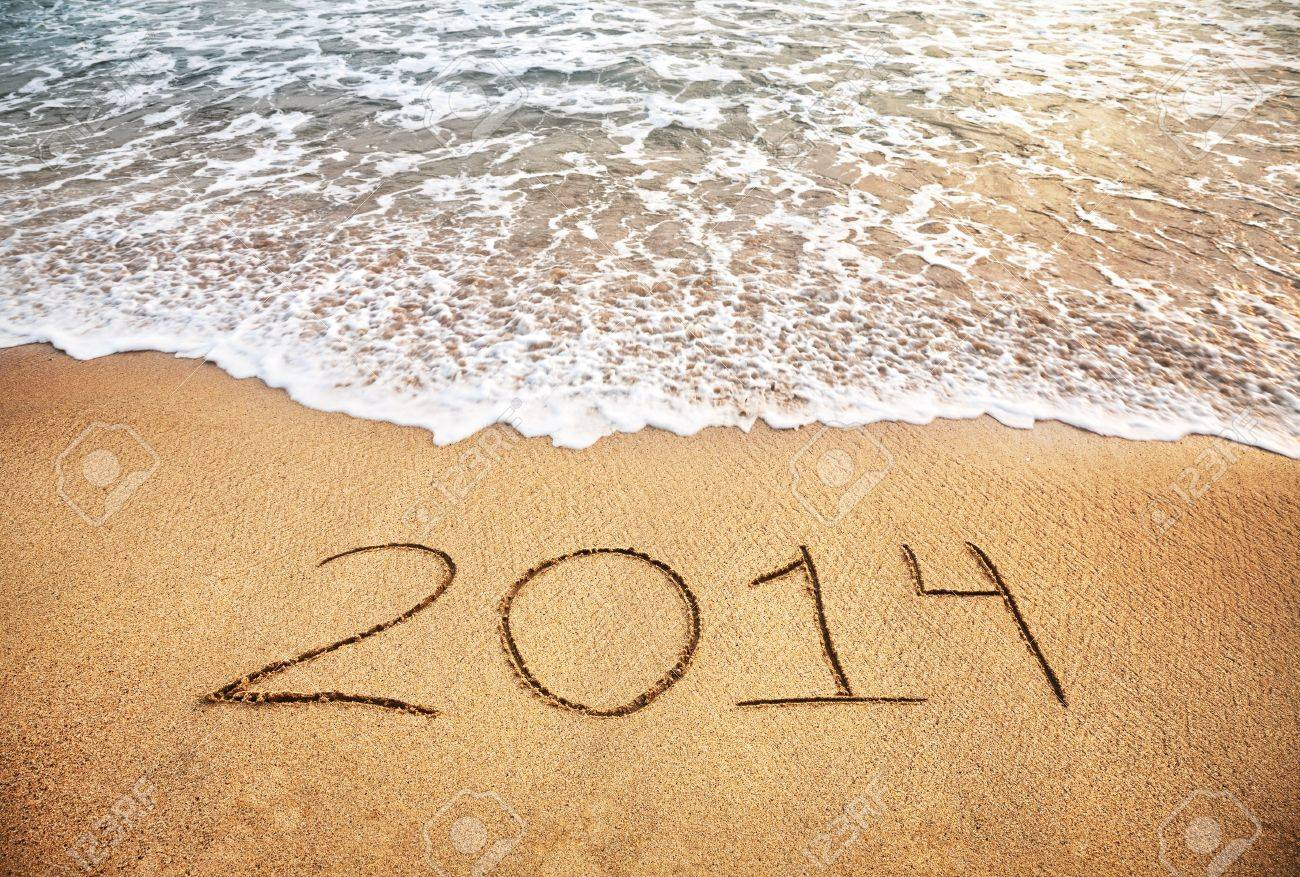 2014 year on the sand beach near the ocean Stock Photo - 17168895