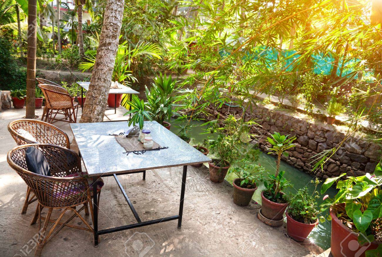Ayurvedic Restaurant Near The Pond At Sunset In Tropical Garden Stock Photo Picture And Royalty Free Image Image 19403719