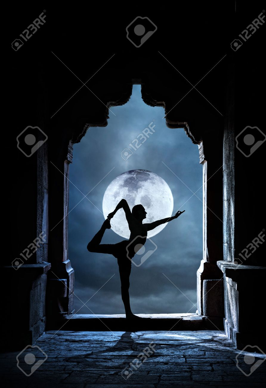 Man silhouette doing yoga in old temple at full moon night sky background Stock Photo - 23339626