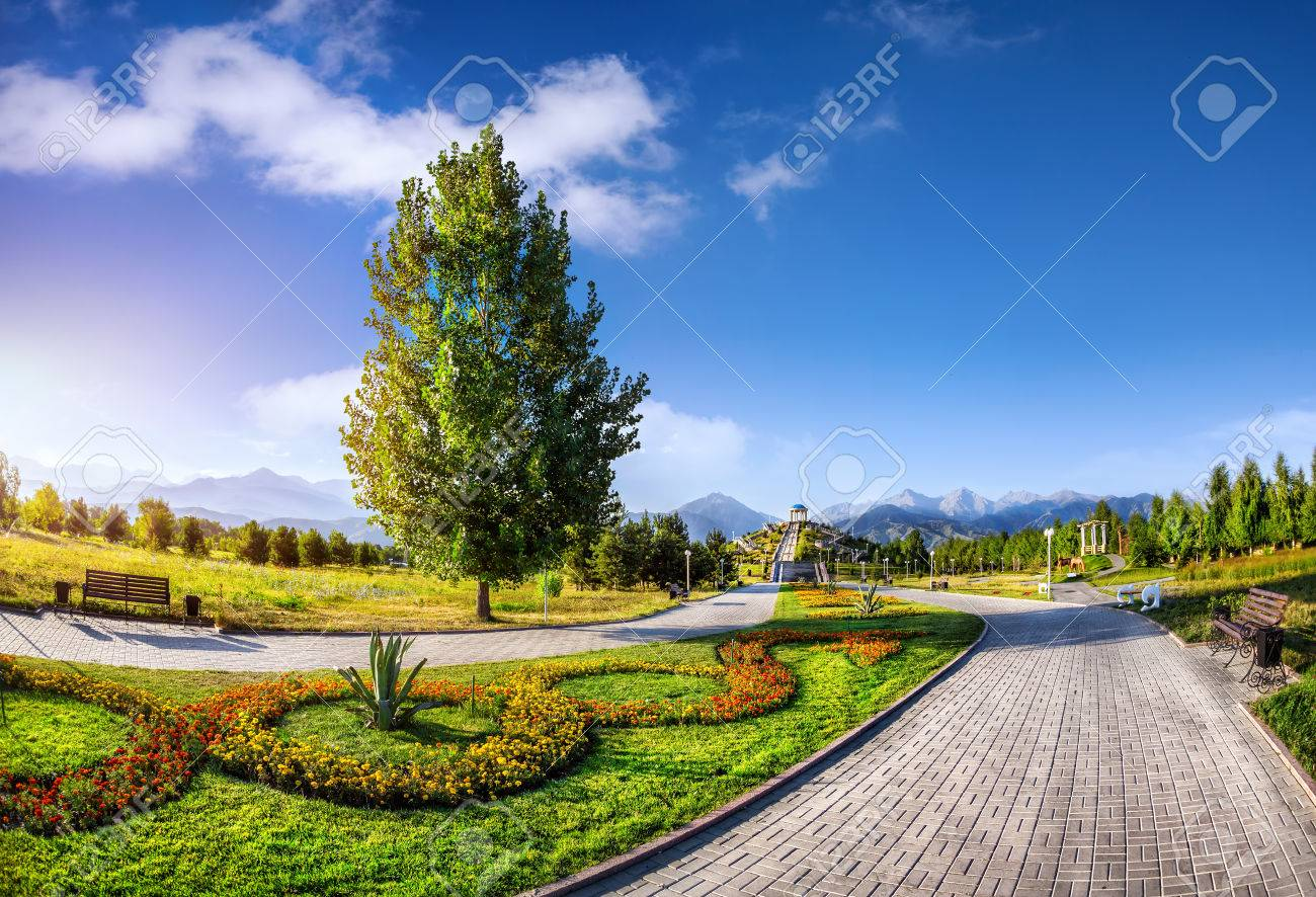 Delightful Flower Garden And Road In The Park Of First President Nursultan Nazarbayev  At Mountains In Almaty
