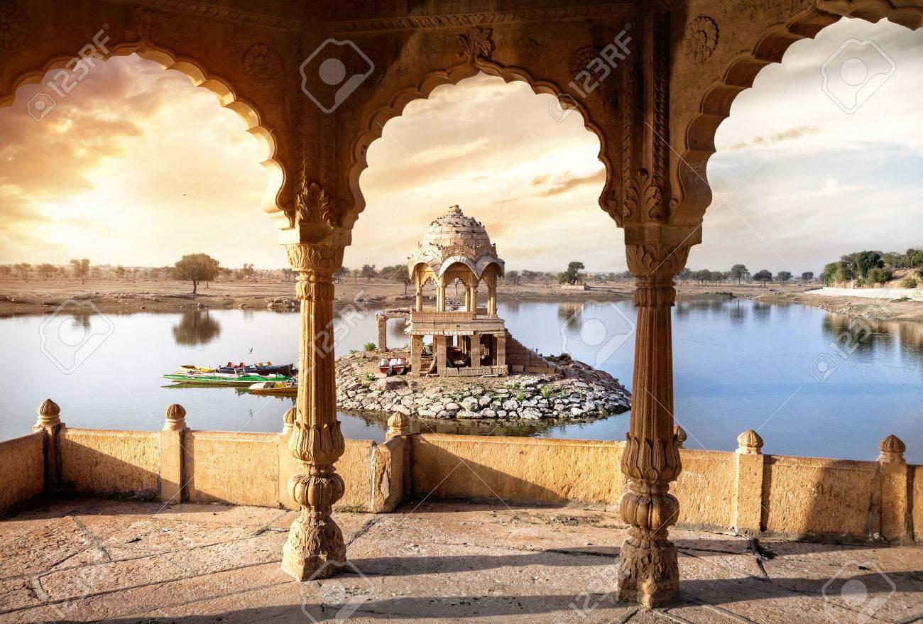 Arches and temple in Gadi Sagar lake at sunset sky in Jaisalmer, Rajasthan, India Stock Photo - 39532870