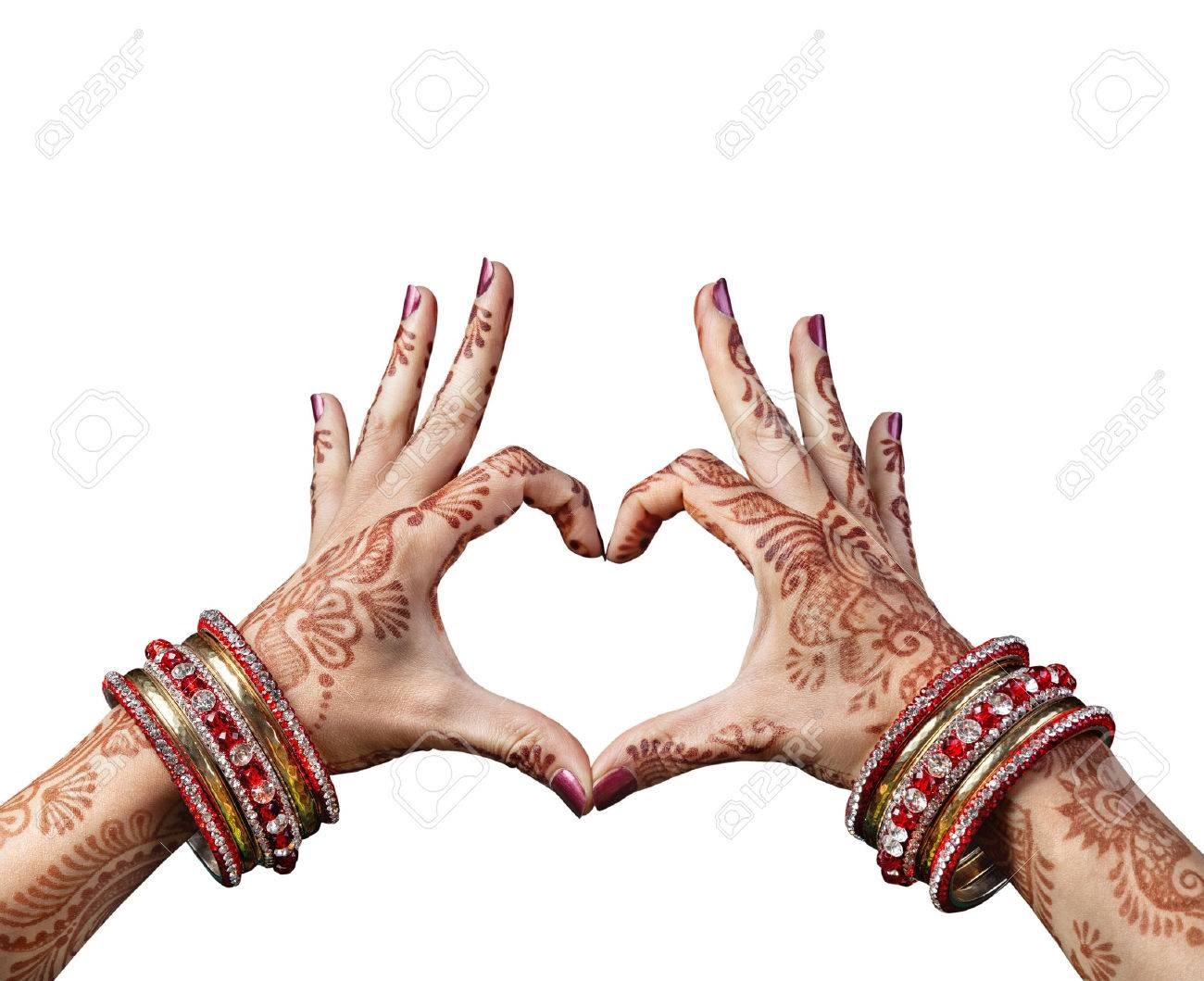 Woman hands with henna doing heart gesture isolated on white background with clipping path Stock Photo - 40010811