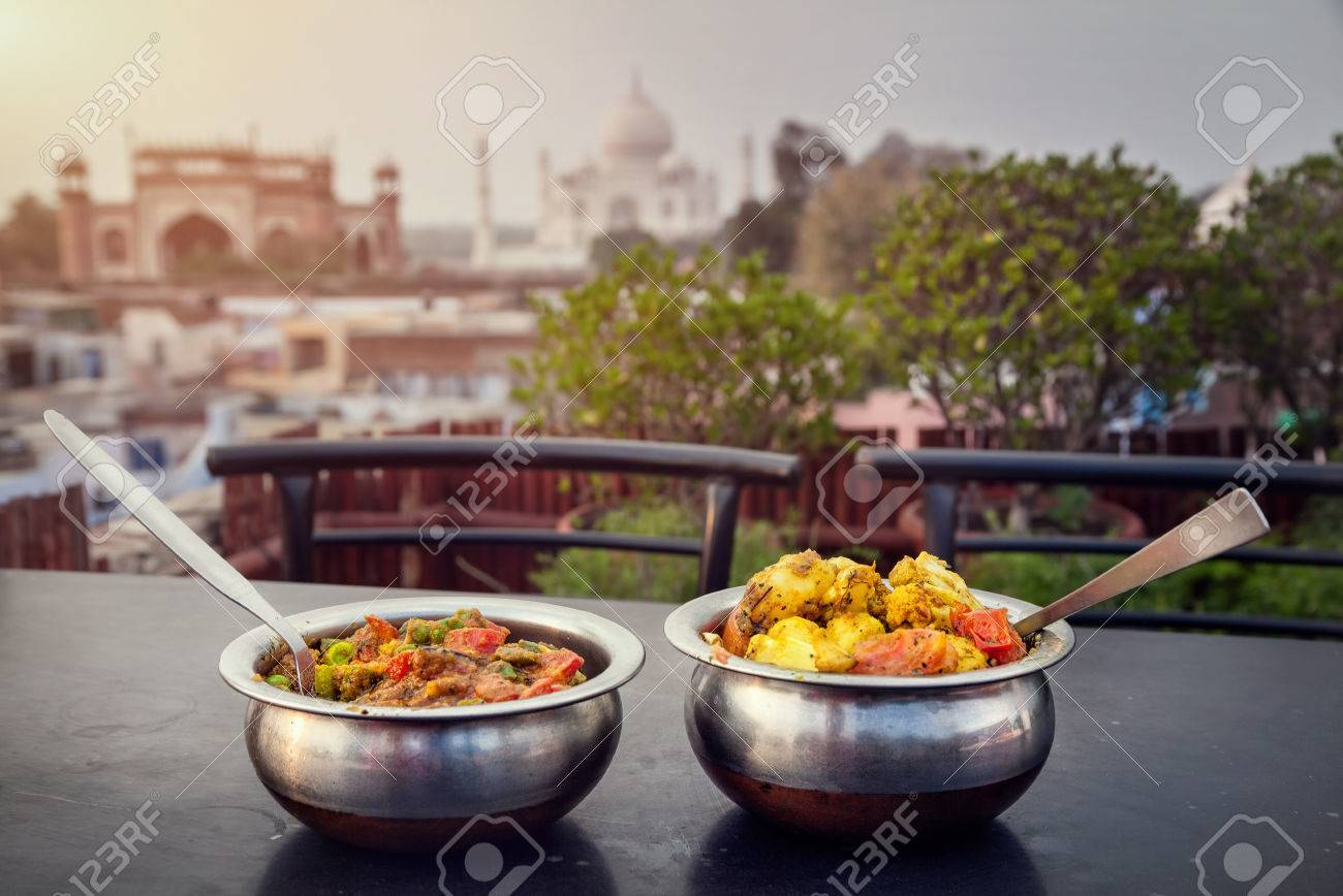 Aloo Gobi and Sabji Masala Traditional Indian food in metal plates on rooftop restaurant with Taj Mahal view in Agra, Uttar Pradesh, India Stock Photo - 40880518