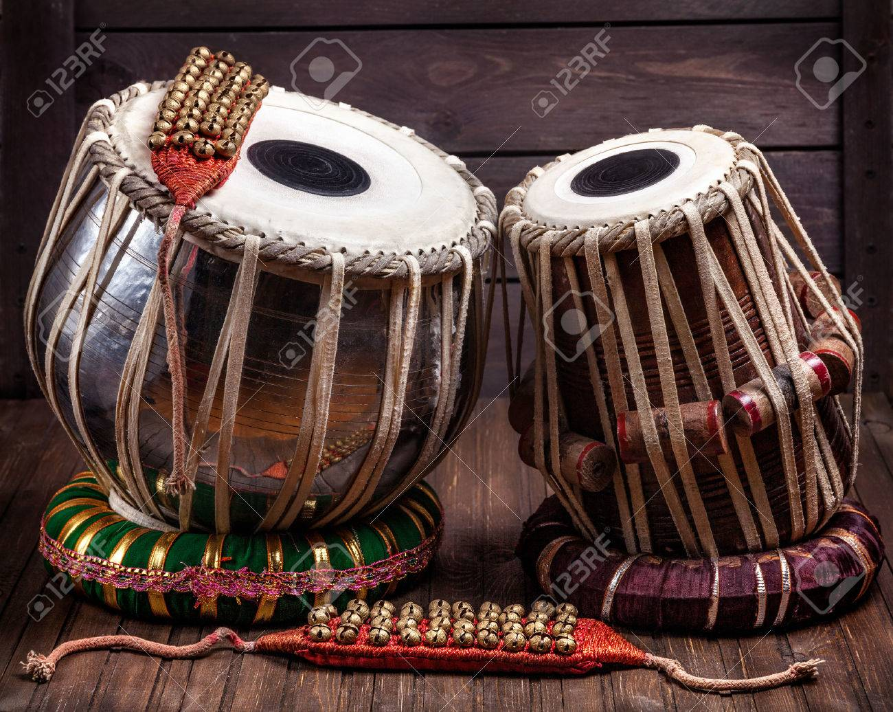 Tabla drums and bells for Indian dancing on wooden background Stock Photo - 42213774