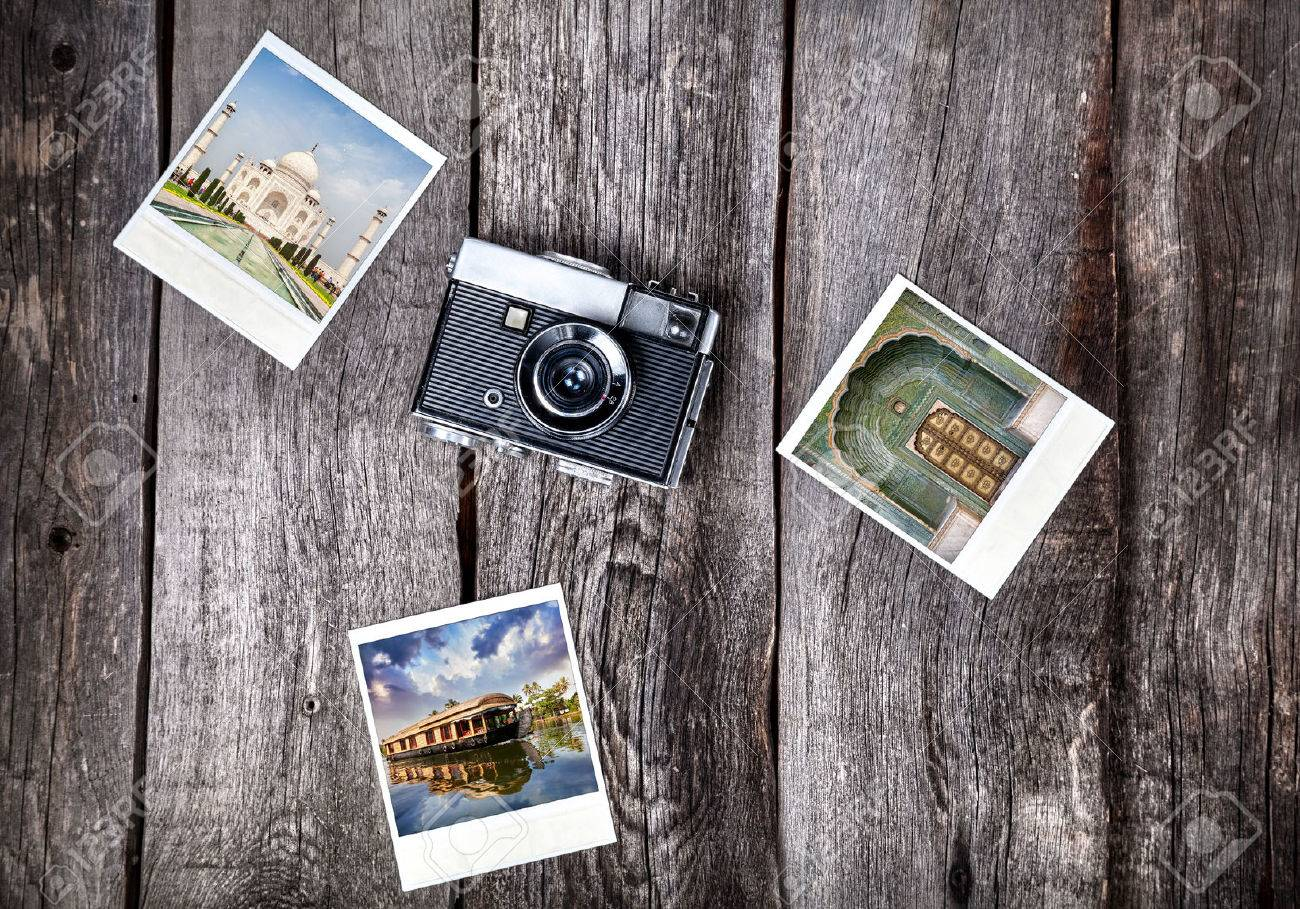 Old film camera and   photos with Indian famous landmarks on the wooden background Stock Photo - 42213967
