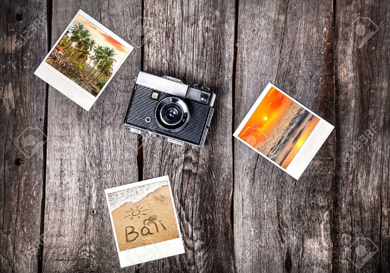 Old film camera and polaroid photos with Bali tropical beaches on the wooden background Stock Photo - 42528417