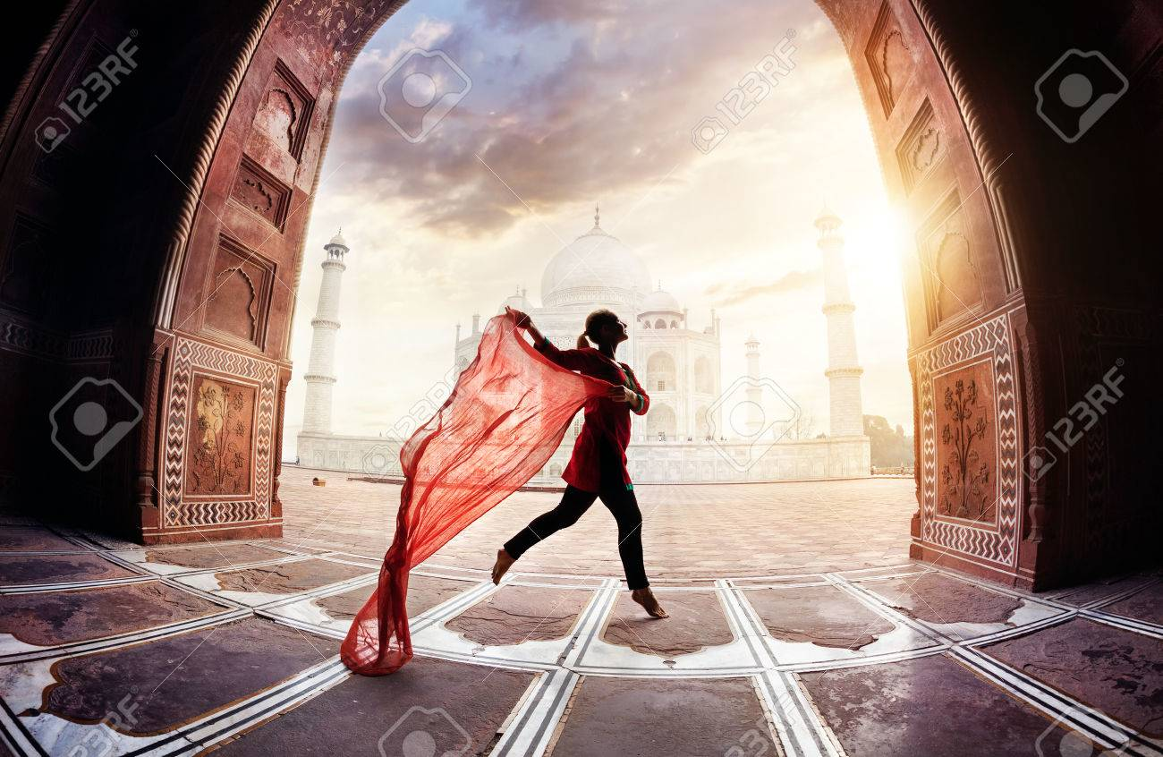 Woman with red scarf dancing near Taj Mahal in Agra, Uttar Pradesh, India Stock Photo - 43074875