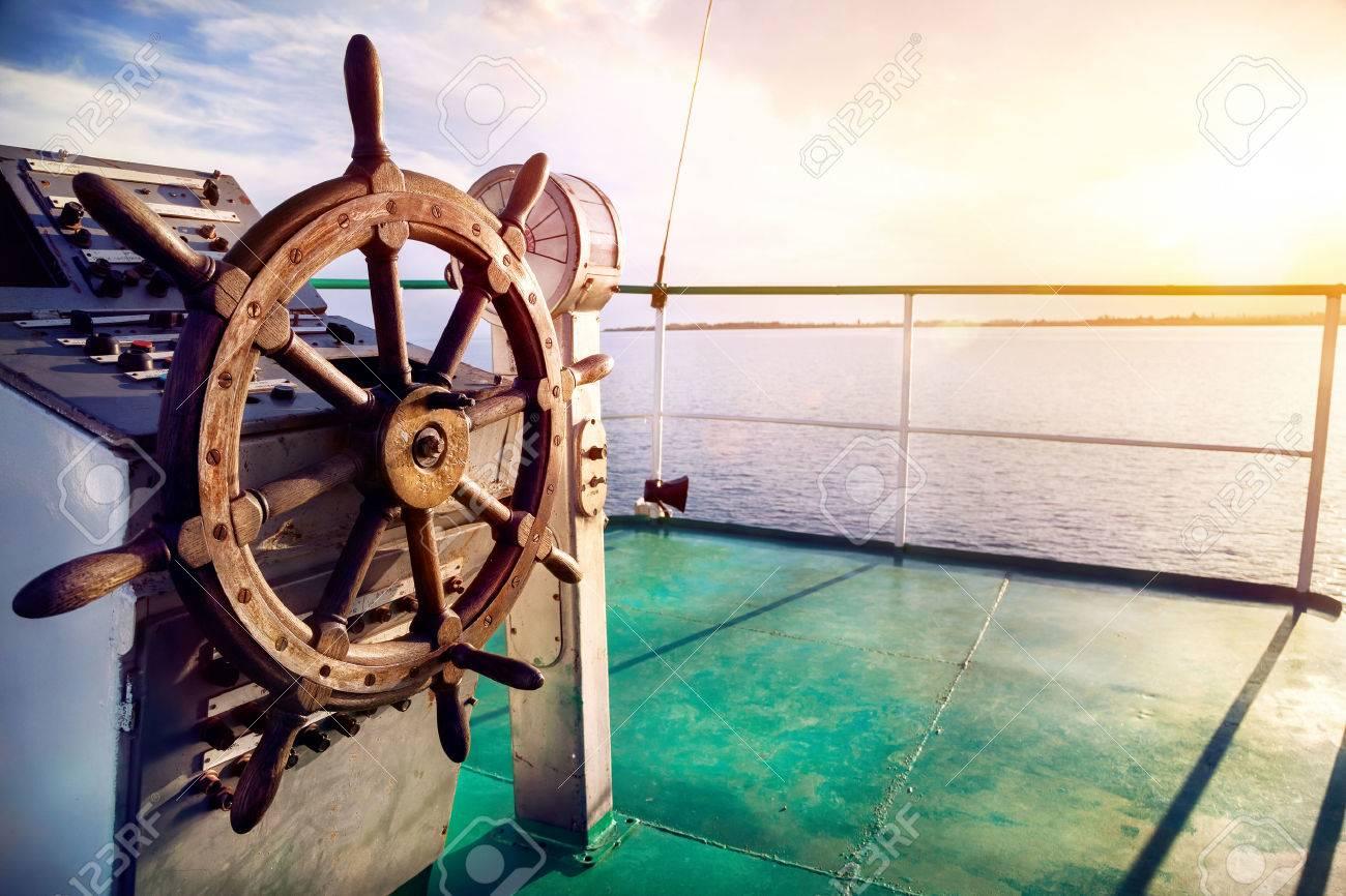Wooden wheel on the ship at sunset on Issyk Kul lake Stock Photo - 43838907
