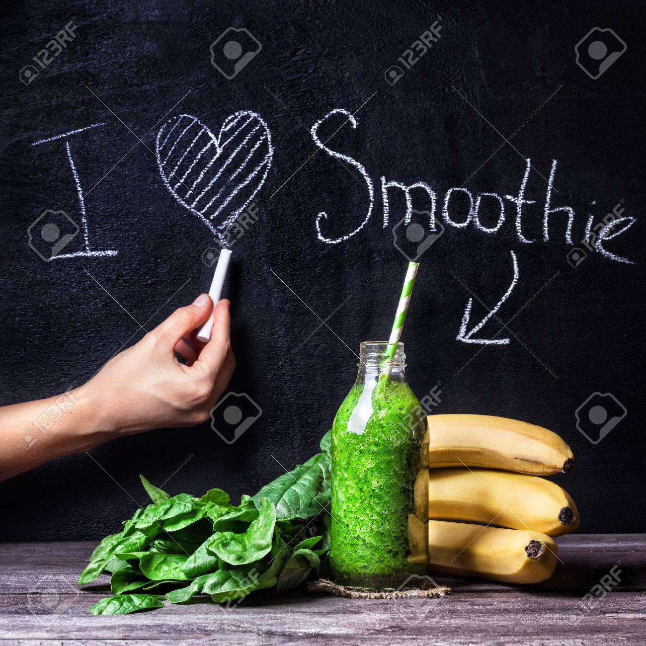 Fresh green smoothie with banana and spinach with title I love smoothie on blackboard Stock Photo - 44585702
