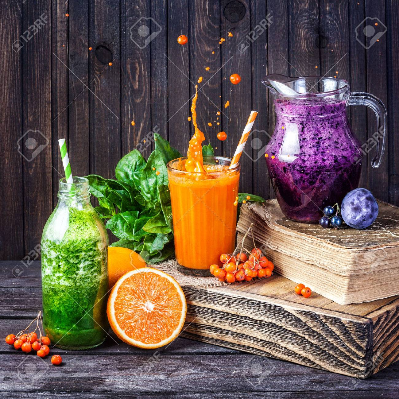 Fresh juice and smoothies with berries, fruits and green spinach on wooden background Stock Photo - 44958549