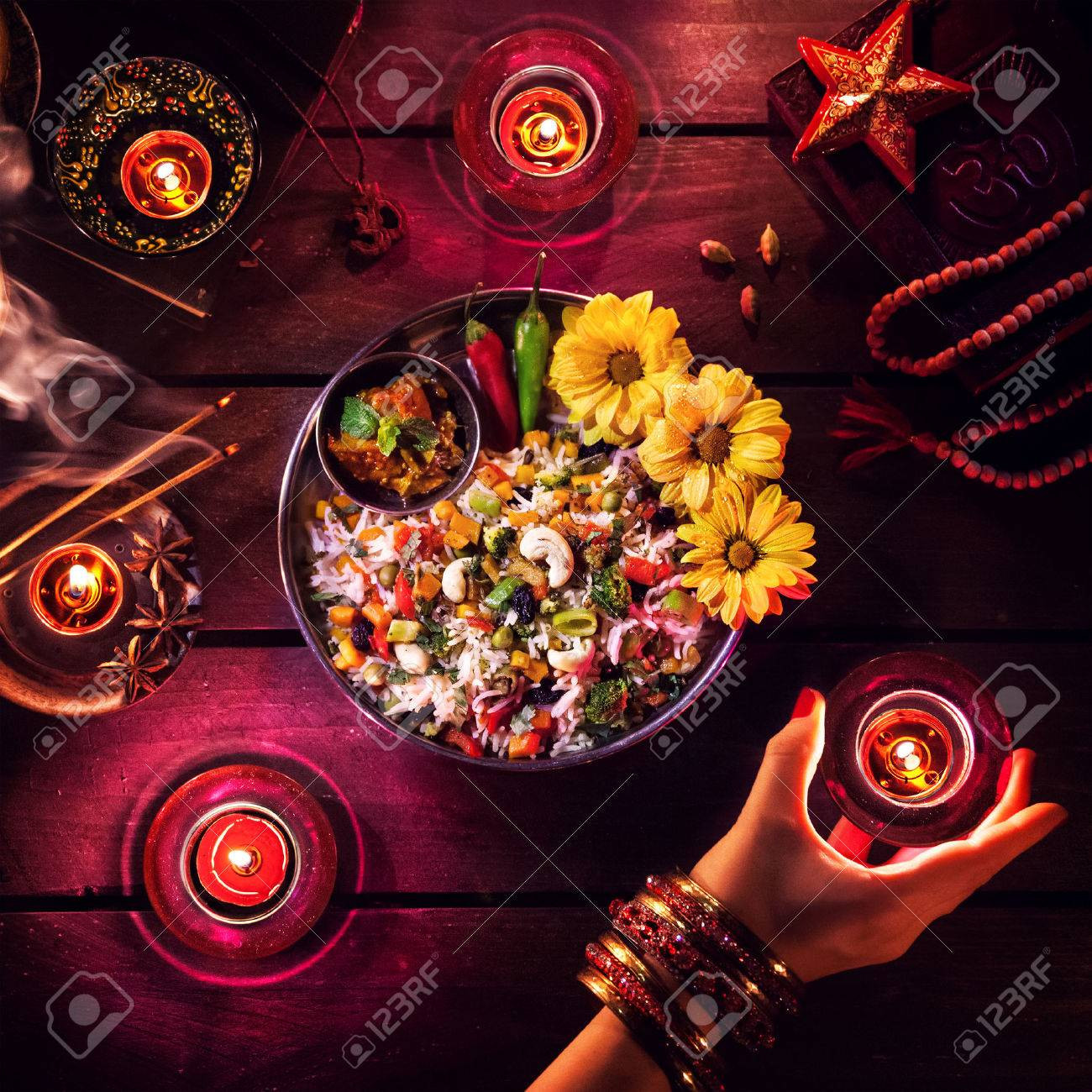 Vegetarian biryani, candles, incense and religious symbols at Diwali celebration on the table Stock Photo - 45388769