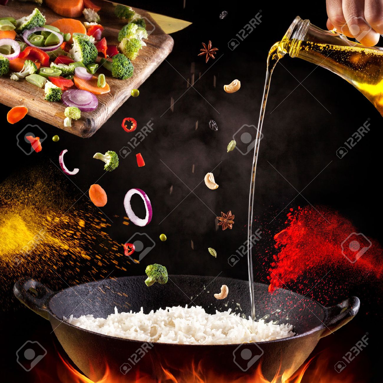 Indian vegetarian biryani with vegetables and spices in cooking process on black background Stock Photo - 45886830