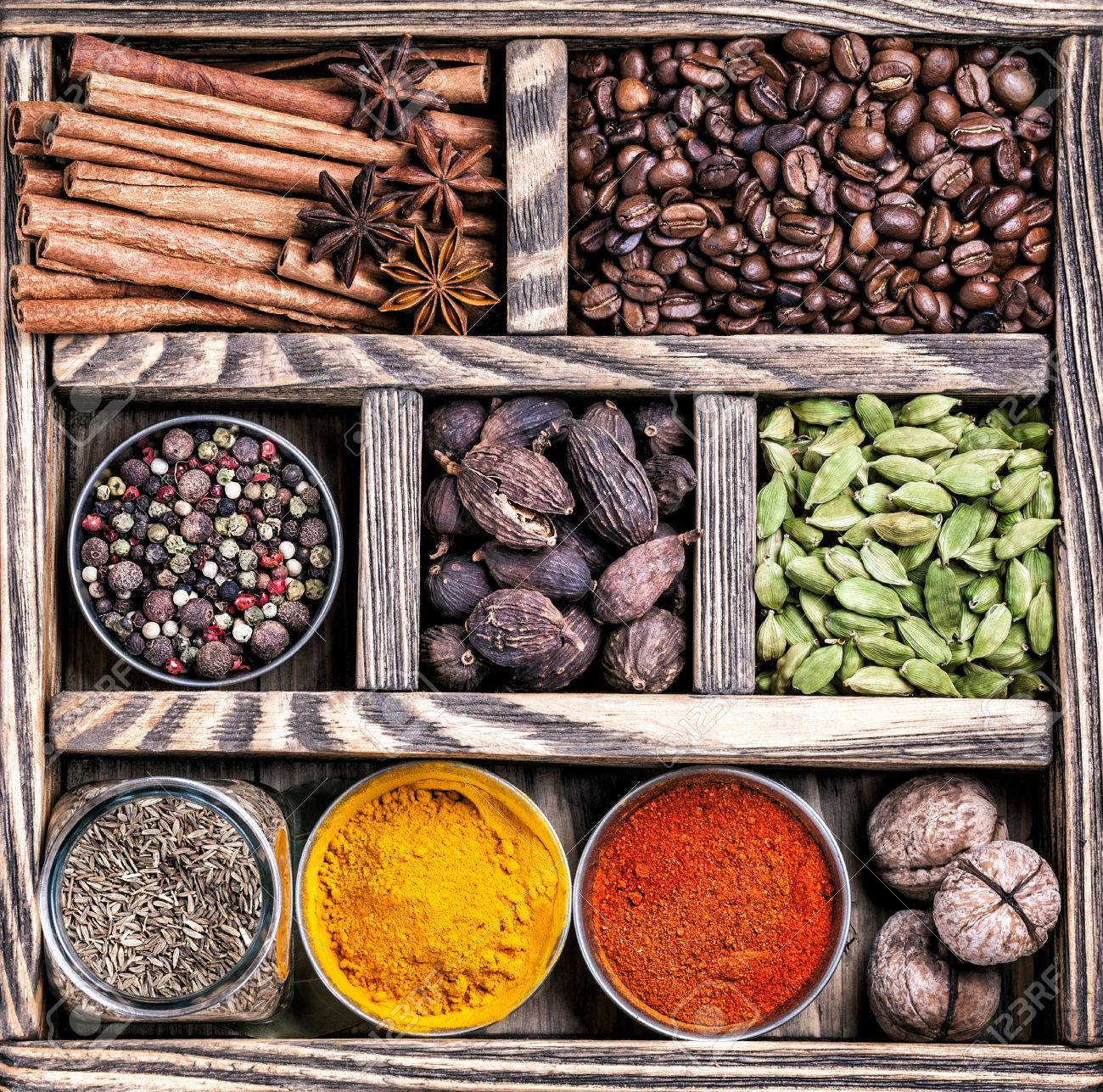 Spices, coffee and walnuts in the wooden box Stock Photo - 46149694