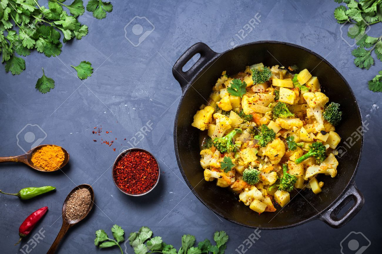 Indian Aloo Gobi dish with potato, cauliflower and spices on the textured grunge background Stock Photo - 47847655