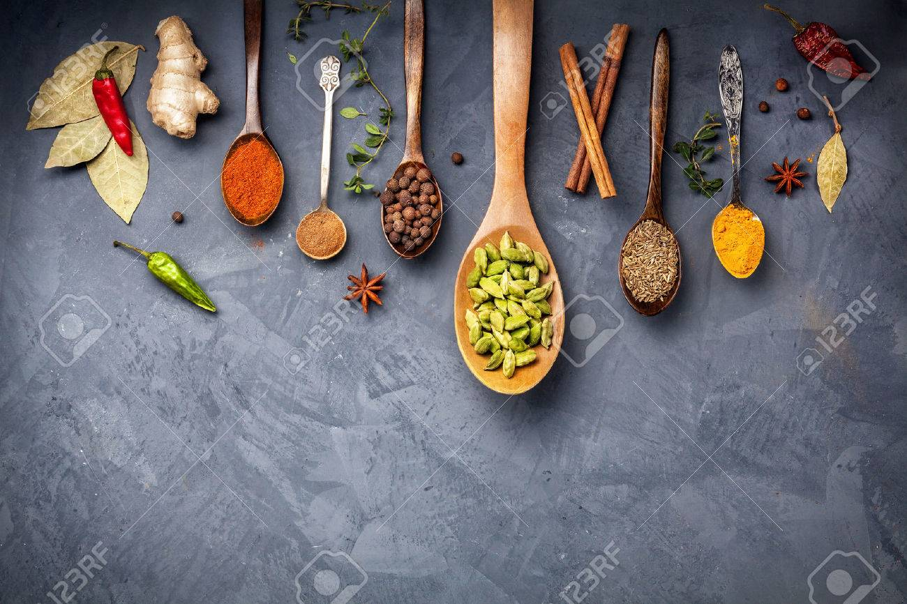 Various Spices like turmeric, cardamom, chili, bayberry, bay leaf, ginger, cinnamon, cumin, star anise on grunge background with space for your text Stock Photo - 47982595