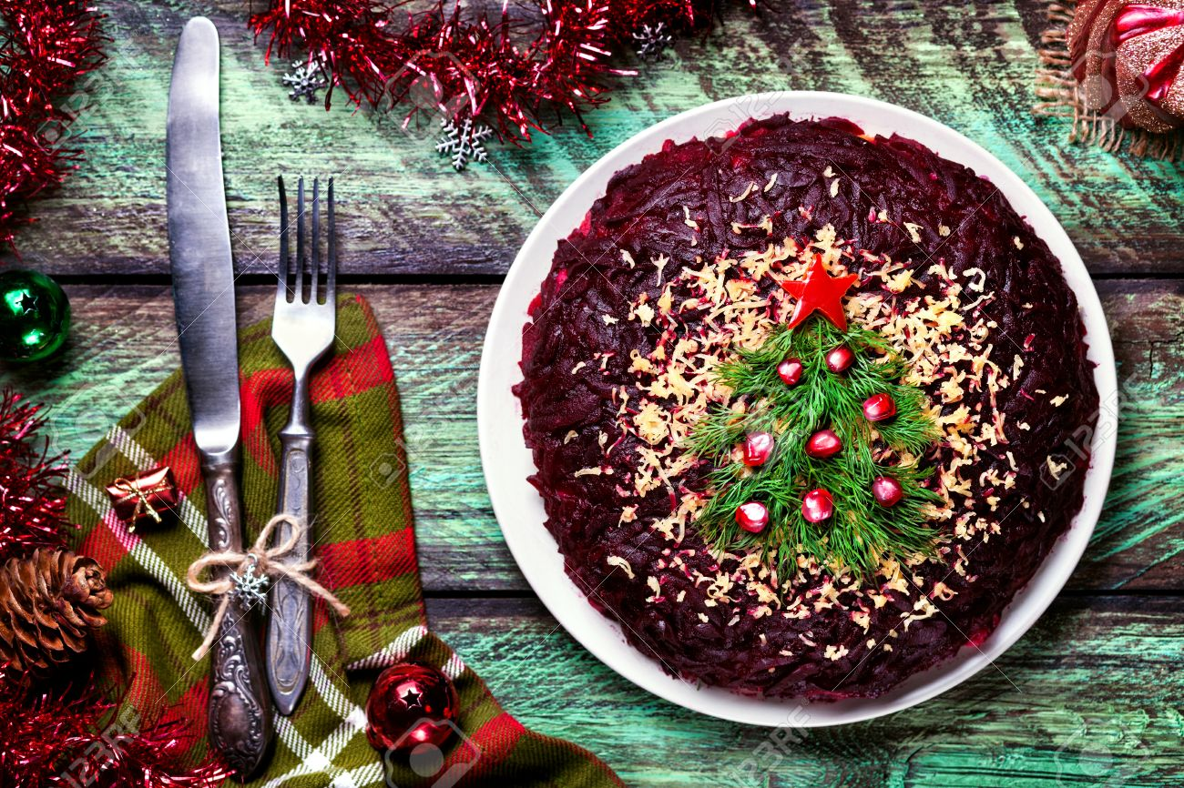 Vegetable salad from beetroot with Christmas tree decoration on the green table at New Year time Stock Photo - 48555314