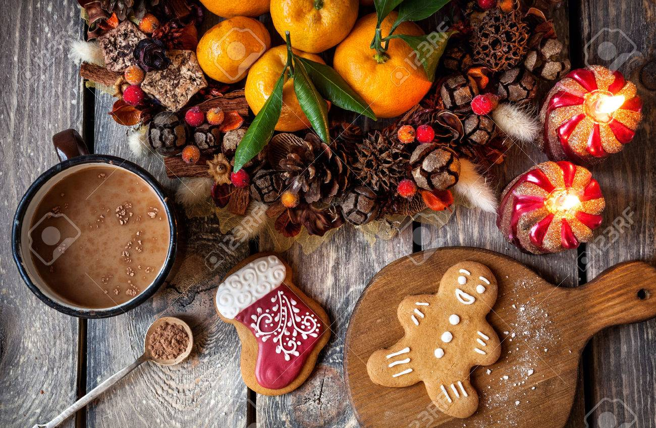 Christmas homemade gingerbread cookies, hot chocolate and candles on wooden table Stock Photo - 49188559
