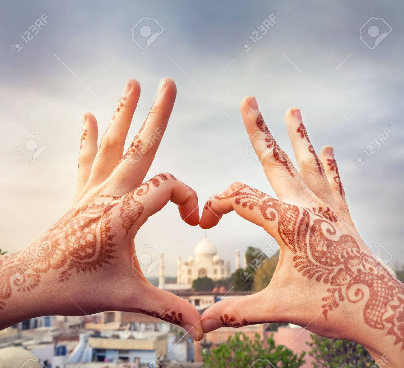 Woman hands with henna painting in shape of heart with Taj Mahal in it. I love India concept with copy space. Stock Photo - 50656341