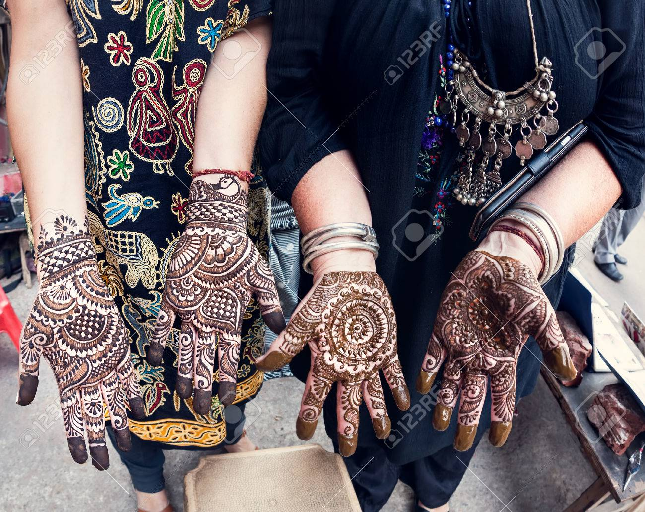 Tourist Woman Showing Them Hands With Traditional Henna Painting