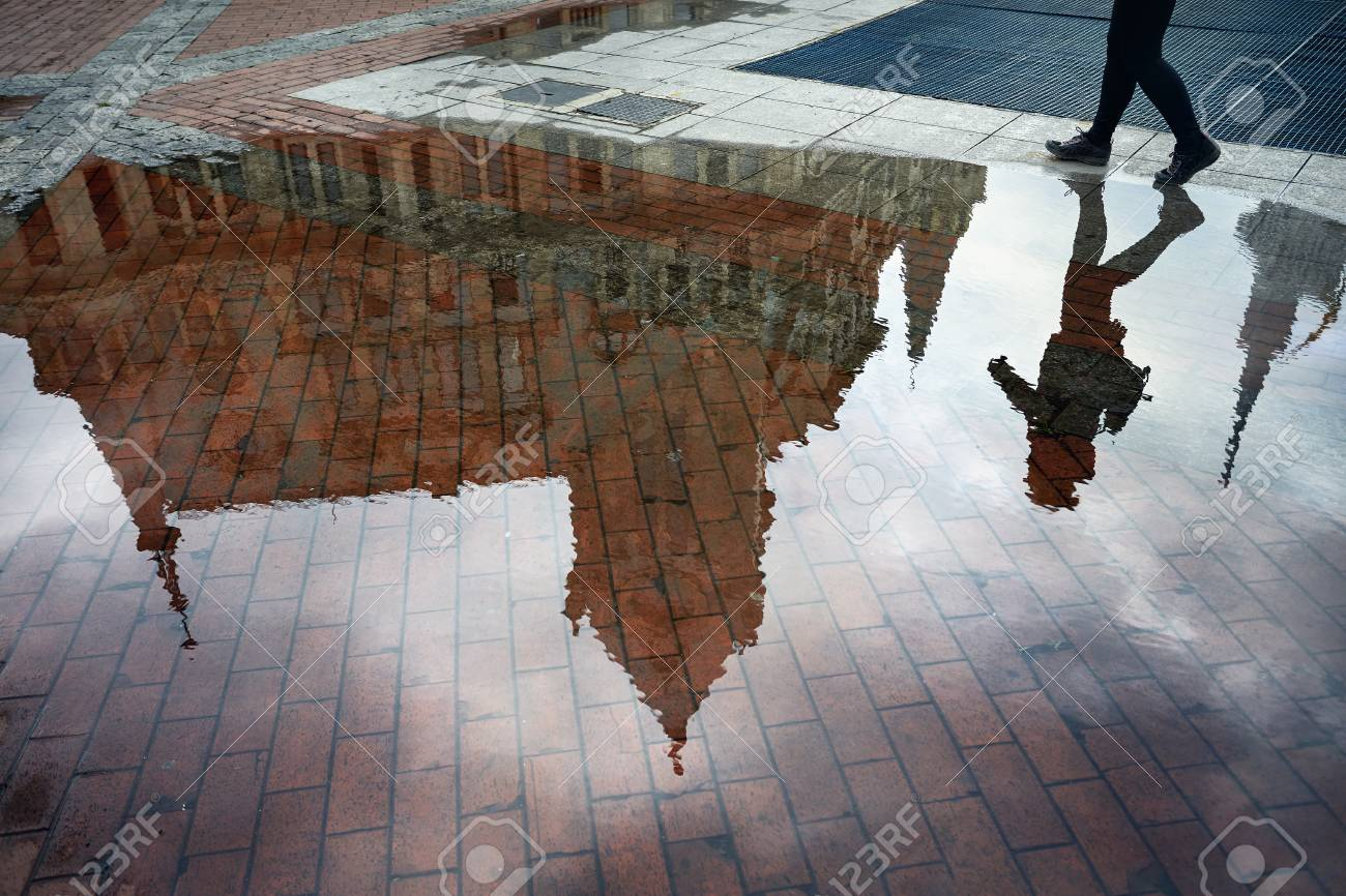 Woman Reflection In Puddle At Europe Square In Batumi Stock Photo ...