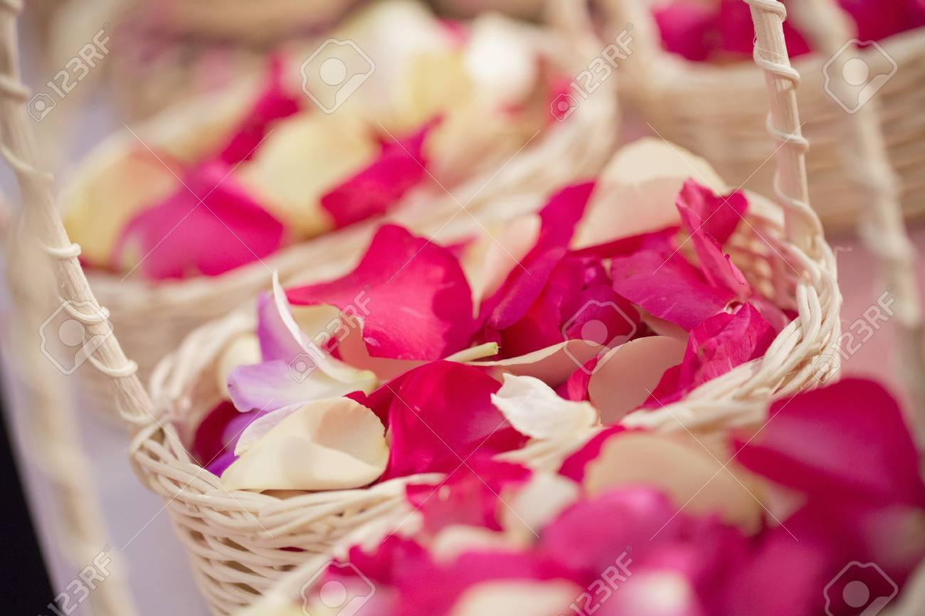Red And White Rose Petals In Baskets Stock Photo, Picture And ...