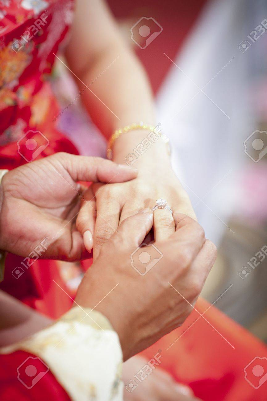 Groom putting a wedding ring Stock Photo - 18775725