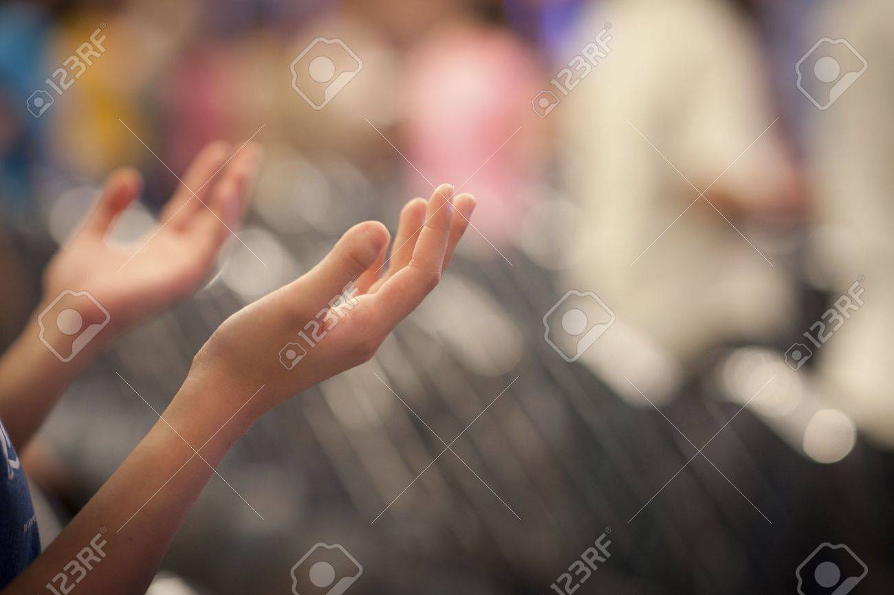 Hands raised like praying or worshiping Stock Photo - 18775557