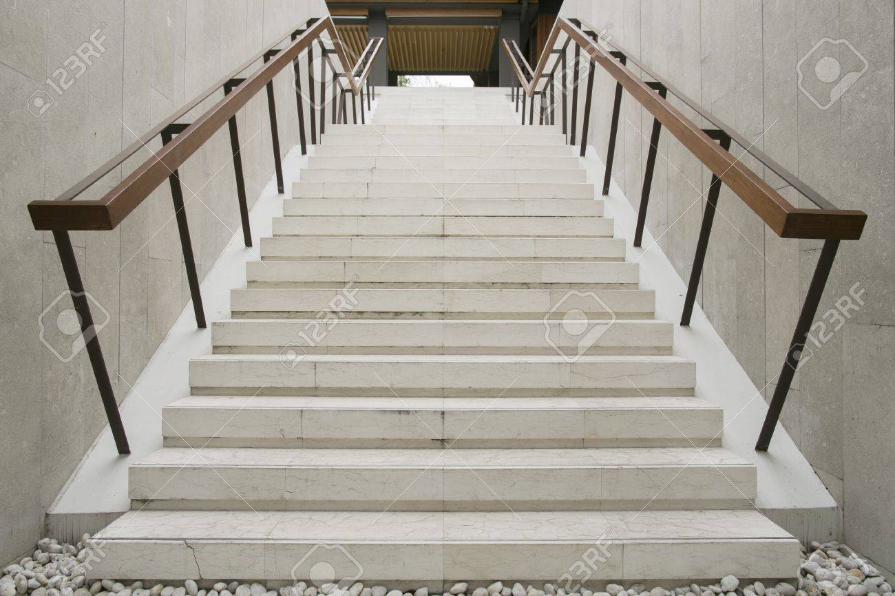 Modern white stairs with wooden handrail Stock Photo - 18775602