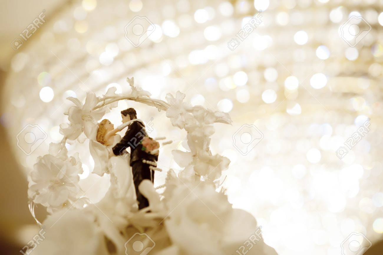 Miniature wedding doll with chandelier background Stock Photo - 18774566