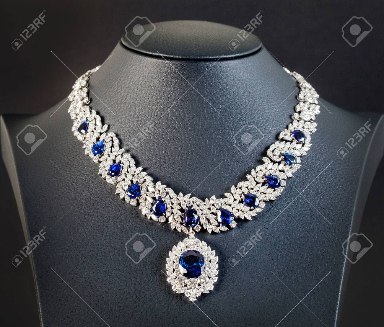 diamonds with dark blue sapphire necklace on the black background Stock Photo - 31349056