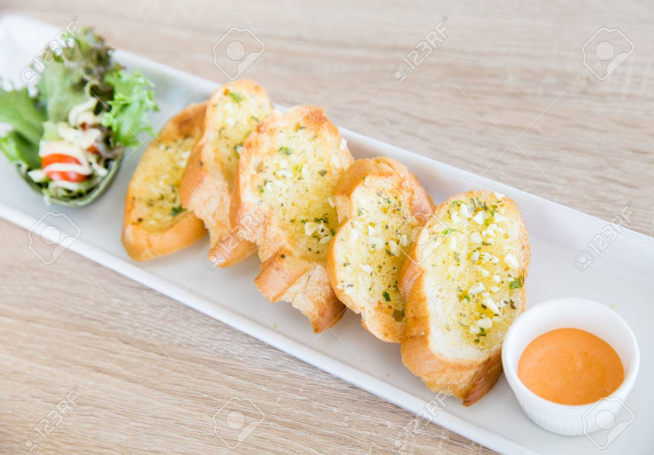 Garlic and herb bread on wooden table Stock Photo - 41550297