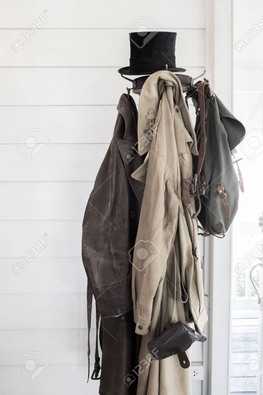 Old Coats And Bag Hanging On Standing Coat Rack Stock Photo