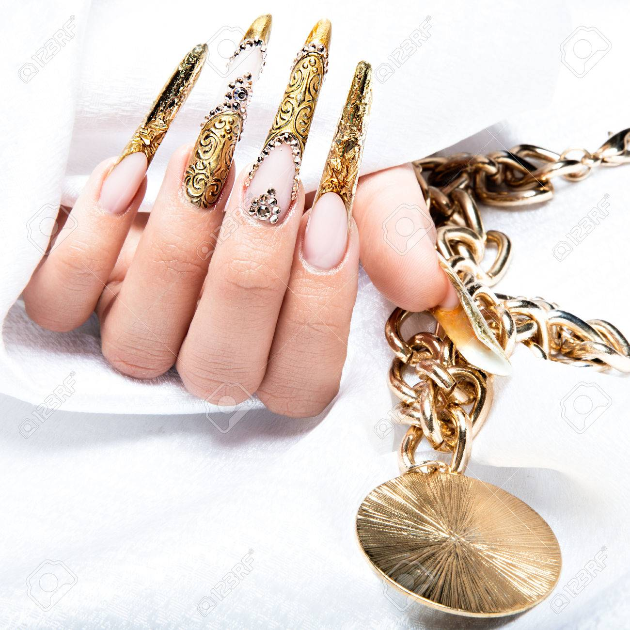 Beautiful Long Nails In A Gold Design With Rhinestones. Nail.. Stock ...