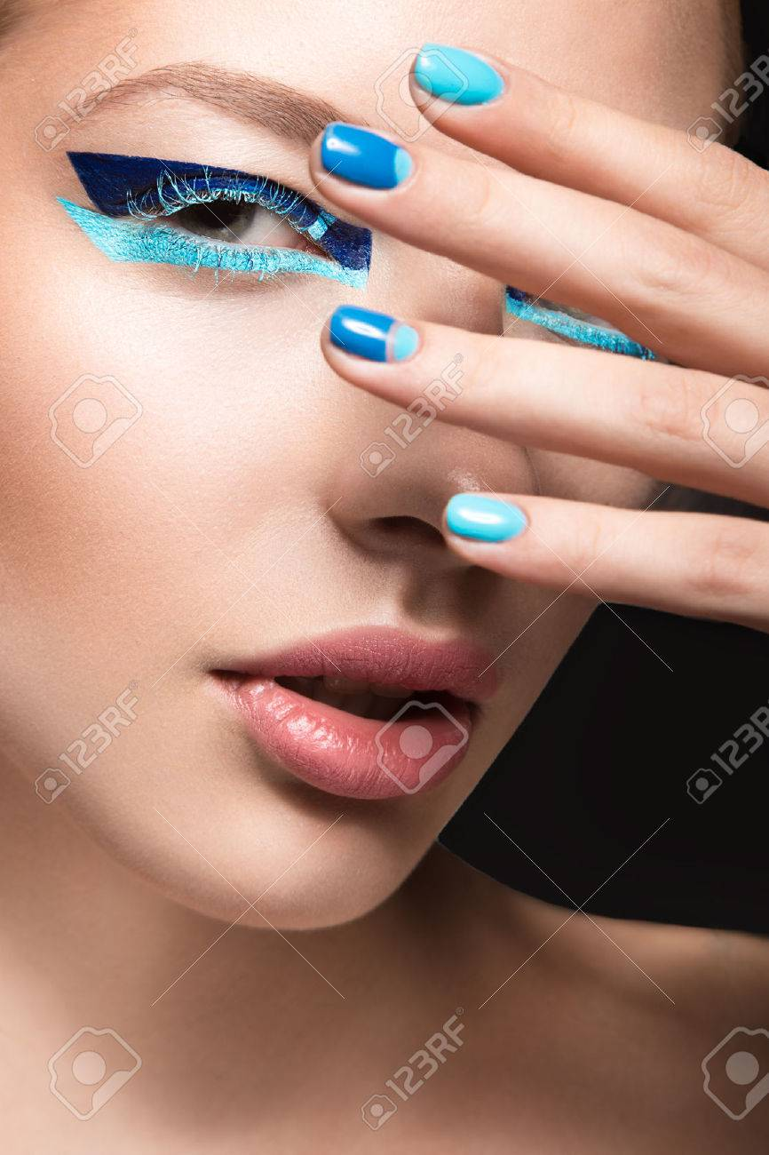 Beautiful Girl With Bright Creative Fashion Makeup And Blue Nail ...