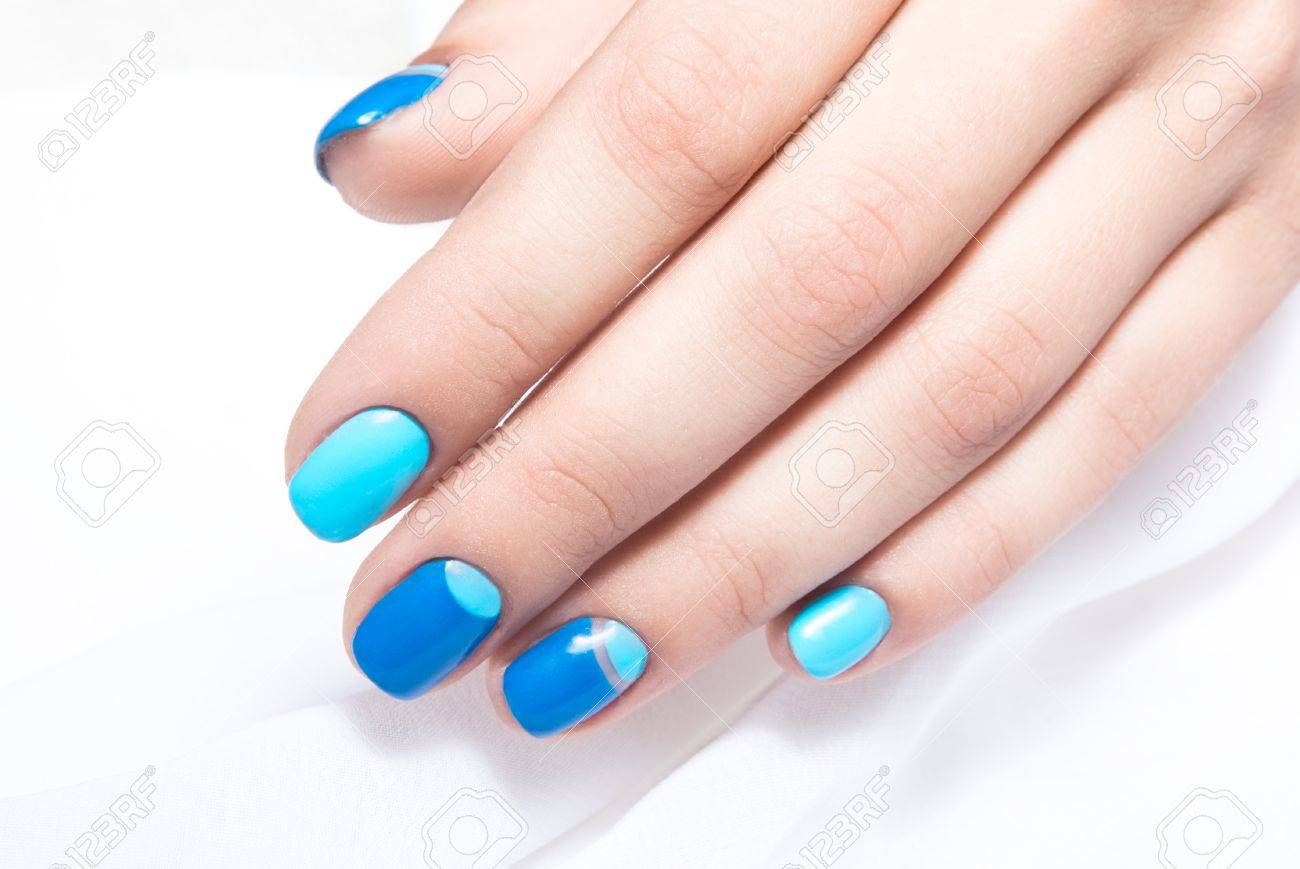 Blue Manicure In Light And Dark Colors Of Lacquer On A White.. Stock ...