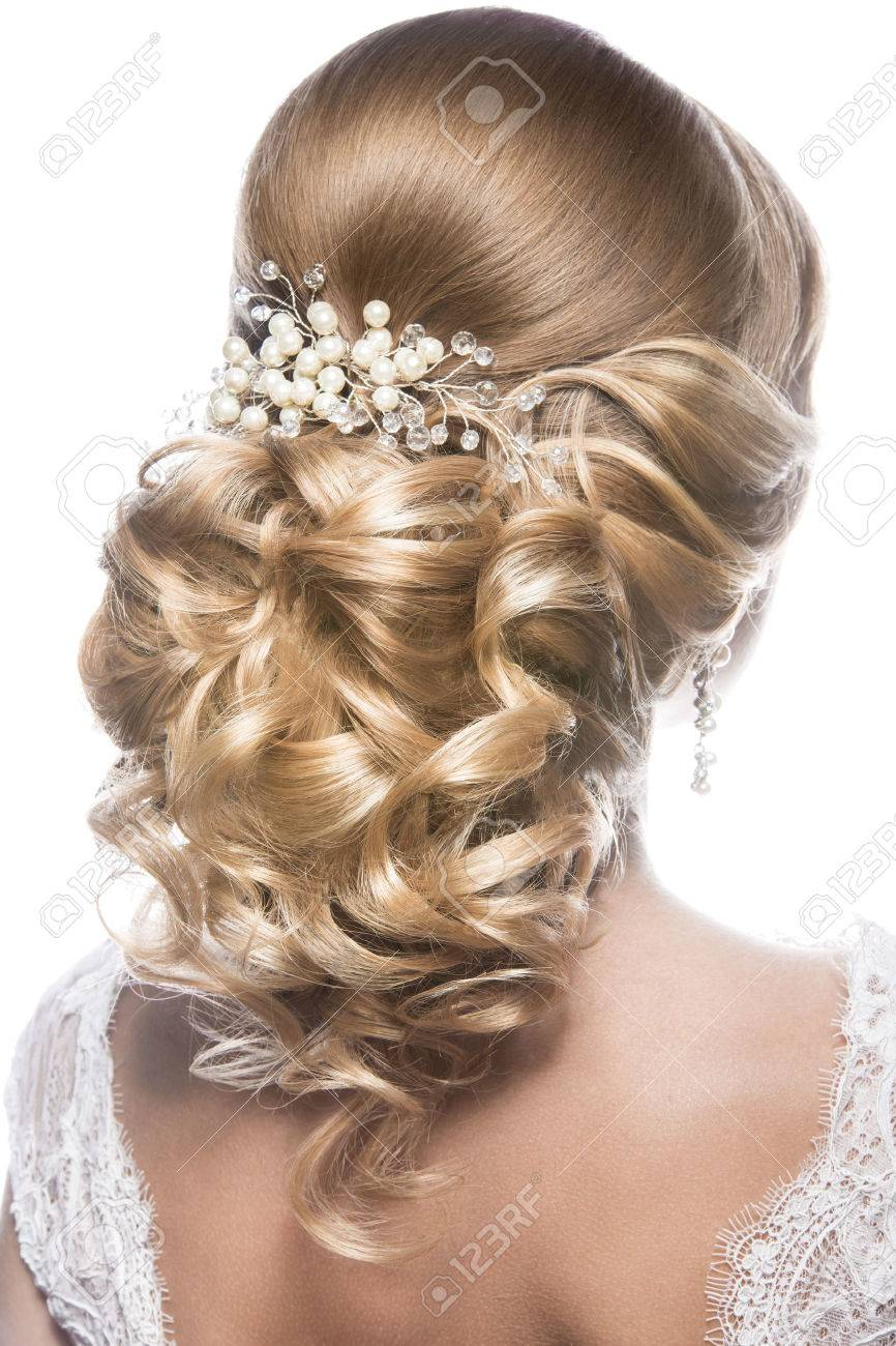 Portrait of a beautiful woman in image of the bride. Picture taken in the studio on a black background. Beauty hair. Hairstyle back view - 43077960