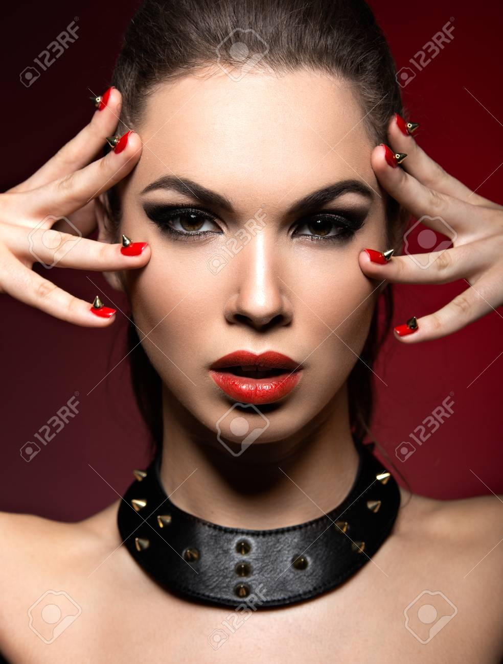 Beautiful Woman In Gothic Style With Evening Makeup And Red Nails Thorns Picture Taken