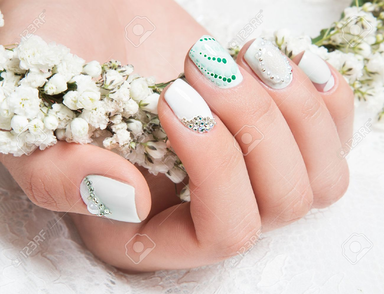 Wedding manicure for the bride in gentle tones with flowers. Nail Design. - 44698456