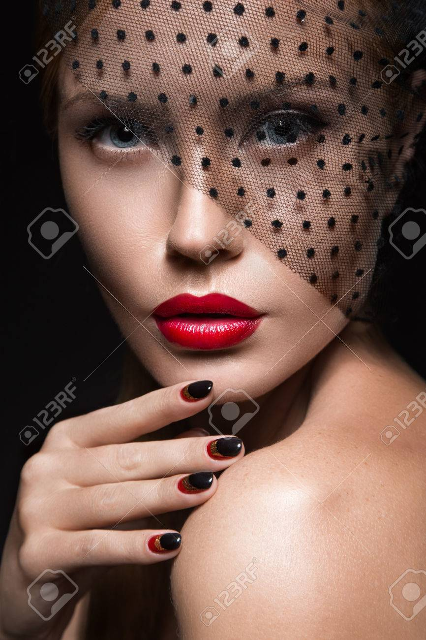 Beautiful girl with a veil, evening makeup, black and red nails. Design manicure. Beauty face. Picture taken in the studio. - 44960091