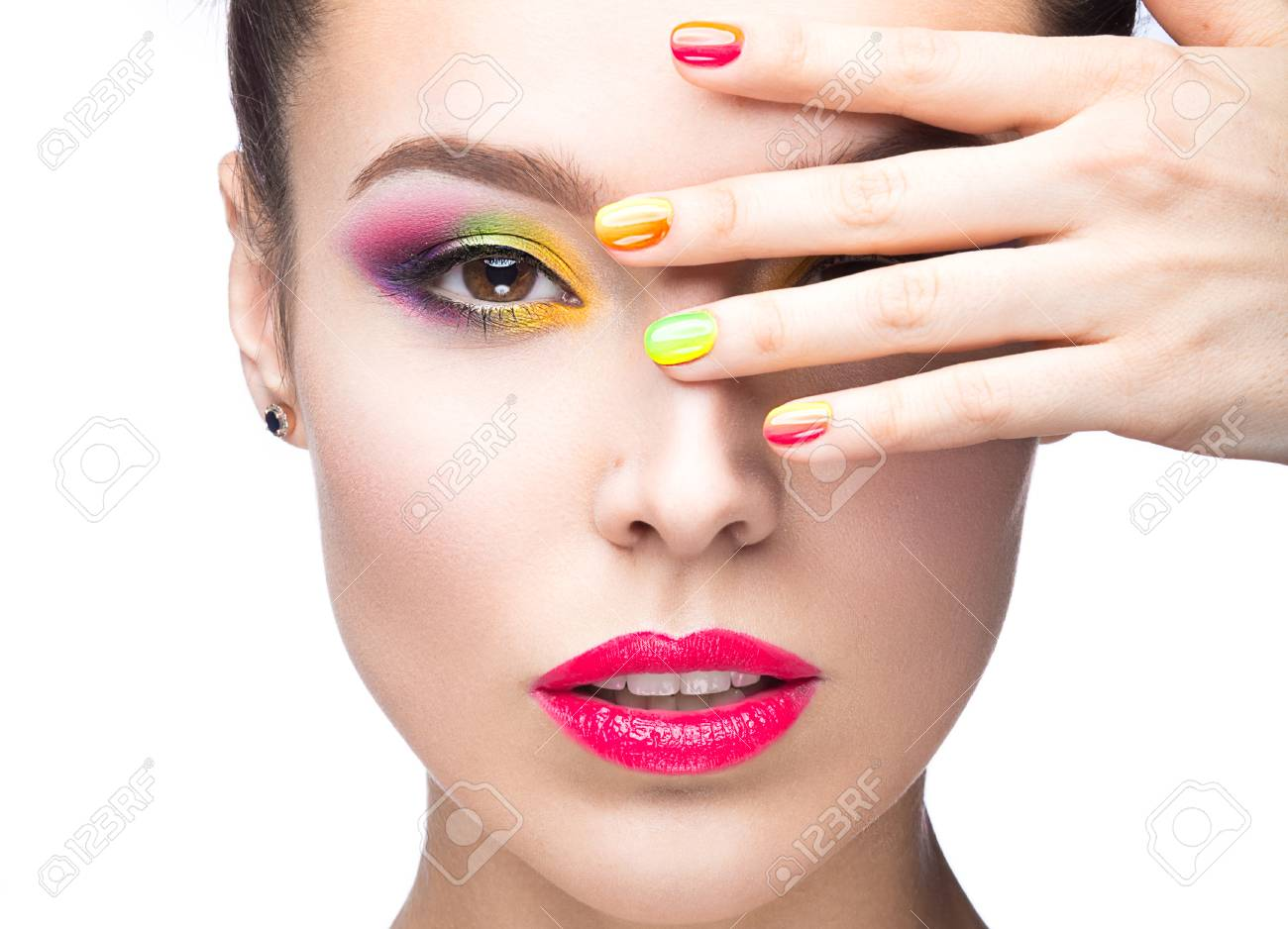Beautiful Model Girl With Bright Colored Makeup And Nail Polish ...