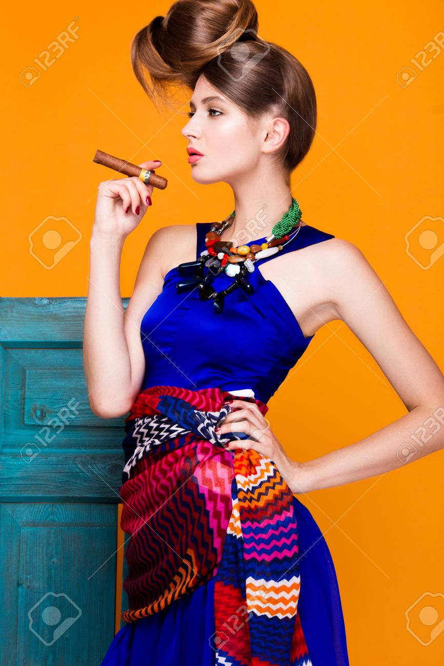 Beautiful Fashionable Woman An Unusual Hairstyle In Bright Clothes